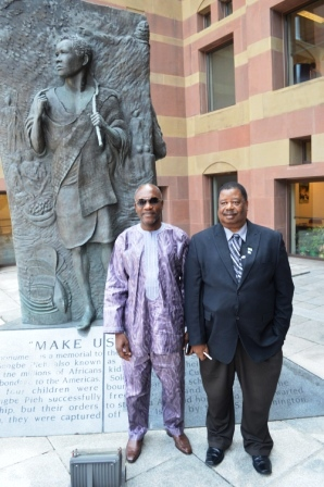 l-r Hon Theo Nicol and Kabbs Kanu in front of the statue of Sengbe Pieh