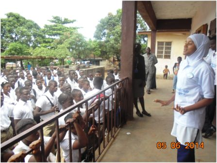 Alima C. Bah, a pupil of the Ahmadiyya Muslim Secondary School speaking to pupils of the Independence Secondary School on dress code